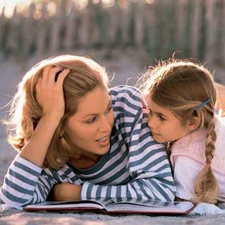 700-42379 © Kevin Dodge Mother and Daughter Reading Outdoors